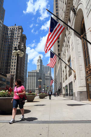 CHICAGO, USA - JUNE 27, 2013: People walk along Michigan Avenue in Chicago. Chicago is the 3rd most populous US city with 2.7 million residents (8.7 million in its urban area).