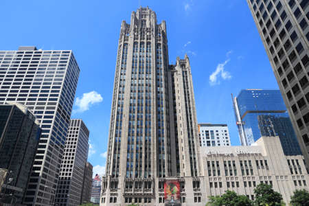CHICAGO, USA - JUNE 27, 2013: Tribune Tower neo-gothic skyscraper in Chicago. It is 462 ft (141 m) tall and is part of Michigan-Wacker Historic District. 新闻类图片