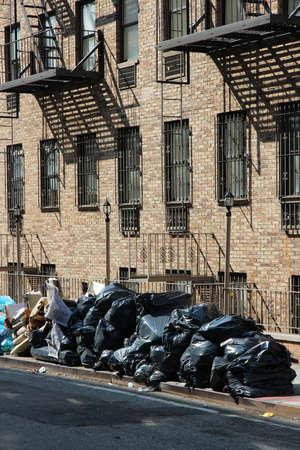 New York garbage bags - household waste waiting for pickup on a Manhattan sidewalk.