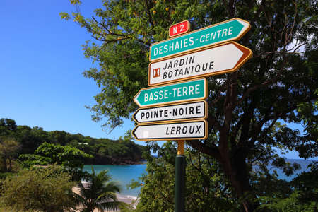 Guadeloupe destinations sign: directions to Deshaies, Basse-Terre and Pointe Noire.