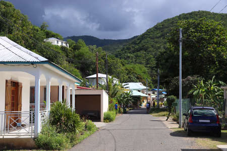 Deshaies, Guadeloupe. Typical local town street in the island of Basse-Terre. Banque d'images