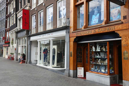 AMSTERDAM, NETHERLANDS - JULY 10, 2017: Antique shop at Rokin street in Amsterdam, Netherlands. Amsterdam is the biggest city and capital of the Netherlands.