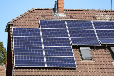 Solar panels on generic house roof. Photovoltaic energy generation near Essen, Germany. 版權商用圖片