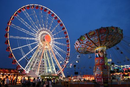 Carnival Wheel And Swinger Stockfoto