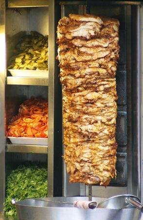 Authentic turkish doner kebap rolling outside of a restaurant on the streets of Istanbul, Turkey.