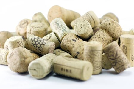 A pile of wine corks on a white background. (Blury edges) photo