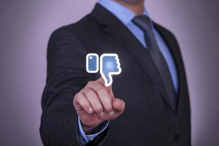 Man Presses a Dislike Button photo