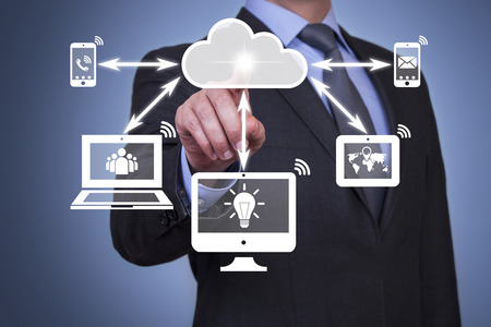 analyze data: Pushing cloud computing button on touch screen Stock Photo