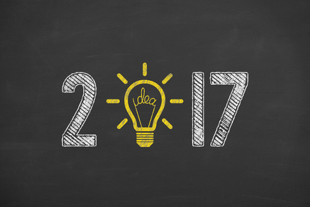 New Year 2017 Concept Idea on Chalkboard Background