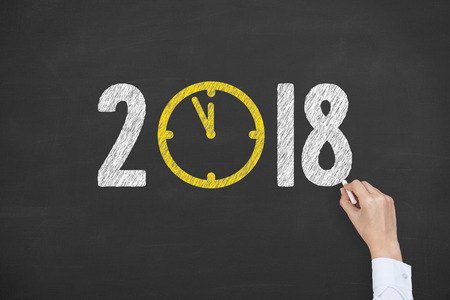 New year clock counting down on Blackboard Stock Photo