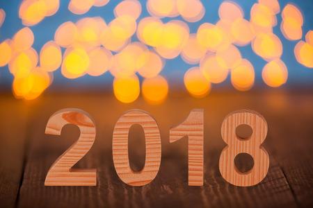 Houten nummers 2018 op het bureau Stockfoto