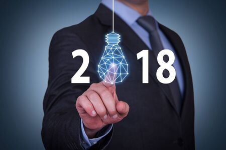 Human Hand Touching New Year 2018 Innovation Concepts on Visual Screen Imagens