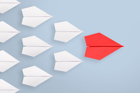 Leadership concept with red paper ship leading among white Standard-Bild