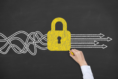 Business Person Drawing Security Concepts on Chalkboard Background