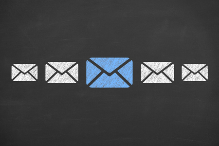 Email concepts on blackboard background