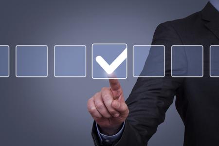 Human Hand Touching Check List on Visual Screen Banco de Imagens