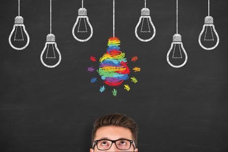 Idea creative concept with light bulbs on a chalkboard background
