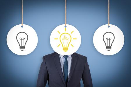 Idea concept with light bulbs on a blue background Banco de Imagens