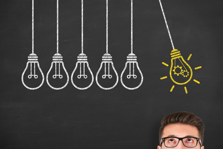 Idea concept with light bulbs on a chalkboard Banco de Imagens