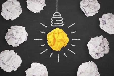 Idea Concepts Light Bulb with Crumpled Paper on Blackboard Background Banco de Imagens