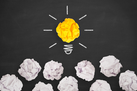 Idea Concepts Light Bulb with Crumpled Paper on Blackboard Background 免版税图像