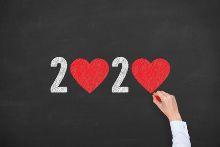 New Year 2020 with Heart Shape on Chalkboard Background