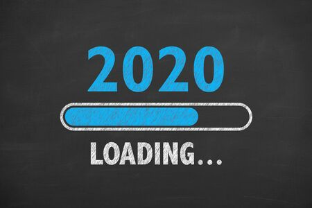 Loading New Year 2020 on Chalkboard Stock Photo