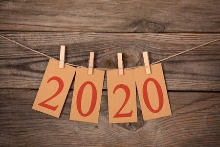 New Year 2020 Concepts Clipped Cards on Wood