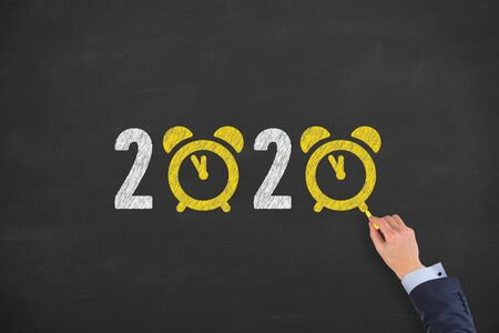 2020 countdown clock over human head on chalkboard background Stock Photo