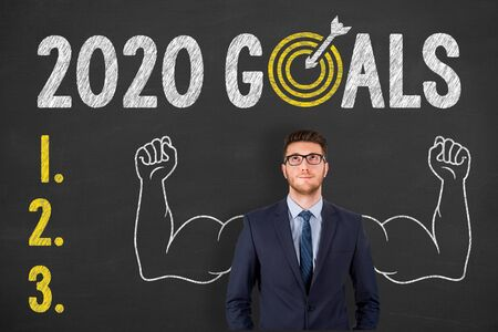 New Year 2020 Goals over Human Head on Chalkboard Background Archivio Fotografico