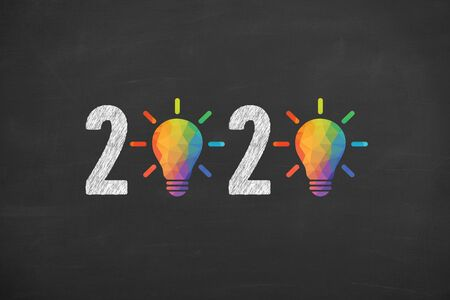 New Year 2020 Creative Idea Concepts on Blackboard Background Stock Photo