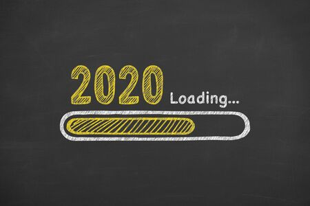 Loading New Year 2020 on Chalkboard Background Archivio Fotografico