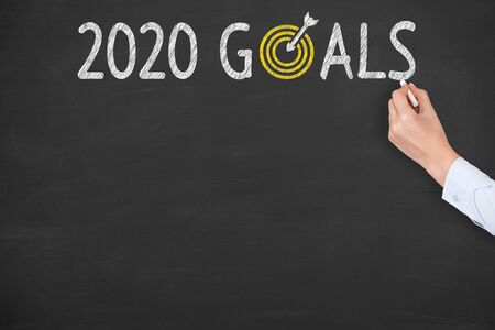 Human Hand Writing 2020 Goals on Chalkboard Background