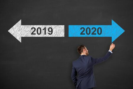 Business Person Drawing 2020 on Blackboard Background Stock Photo