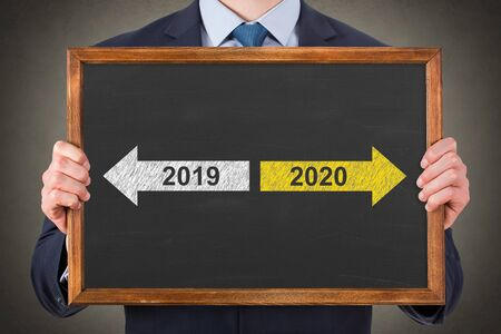 Old Year New Year 2020 on Blackboard Background Archivio Fotografico