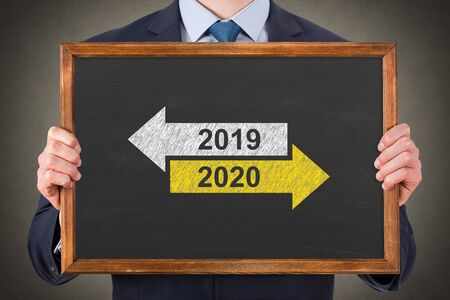 Old Year New Year 2020 on Chalkboard Background