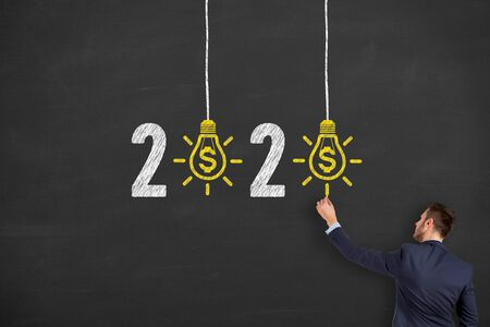 New Year 2020 Finance Concepts on Blackboard Background Stock Photo