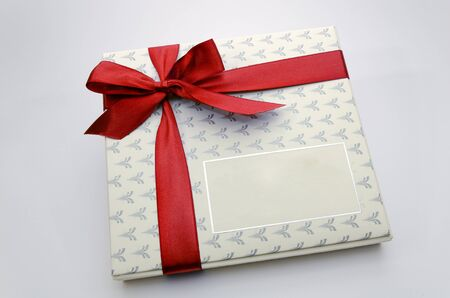 Printed over a red ribbon gift box photo