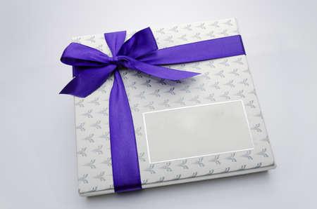 Printed over a purple ribbon gift box photo