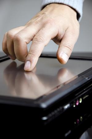 wireless tool: Working men in black tablet pc