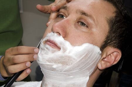 The male barber shave beard photo