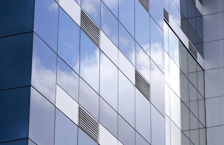 air duct: Glass building with ventilation grills Stock Photo