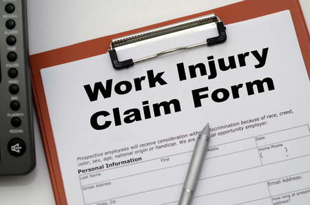 accident patient: Claim form for a work injury on a desk top