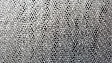 malla metalica: Metal mesh or aluminum grid texture