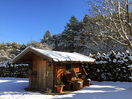 hause: Little wood hause out of town. Blue sky in winter time, everything around in snow
