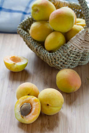 Fresh apricots on wooden table  Stock Photo
