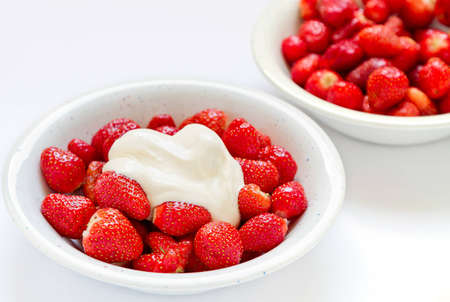 Bowl of fresh strawberries and cream