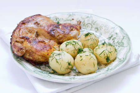 Roasted chicken and potato with vegetables Stock Photo
