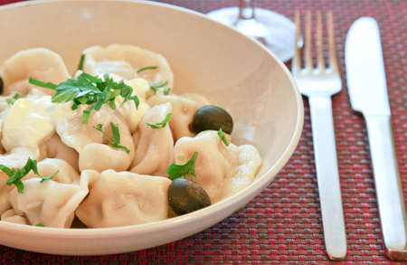 Russian dumplings boiled served on plate