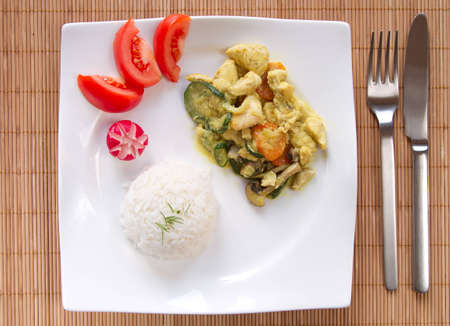 chicken curry on white plate, top view